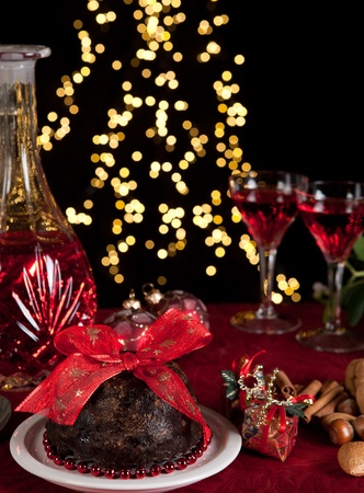 Christmas dinner table with xmas pudding as dessert Stock Photo