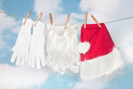 Santa Claus laundry and beard hanging on a clothes line photo