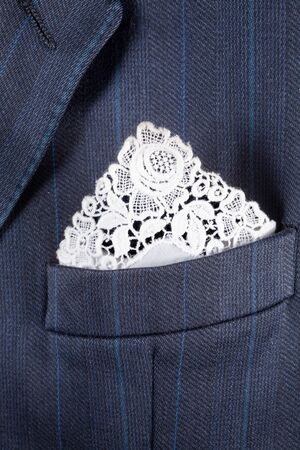 breast pocket: Formal suit breast pocket with a lace white handkerchief