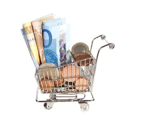 shopping trolley full of money for spending photo