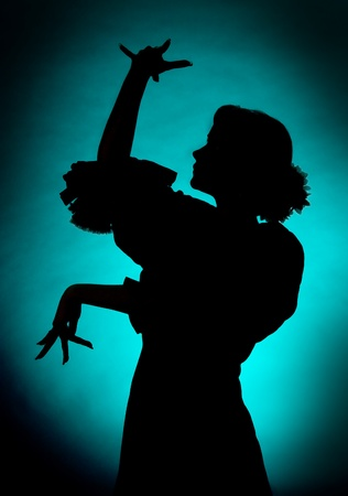 gypsy woman: Silhouette of a young spanish flamenco dancer
