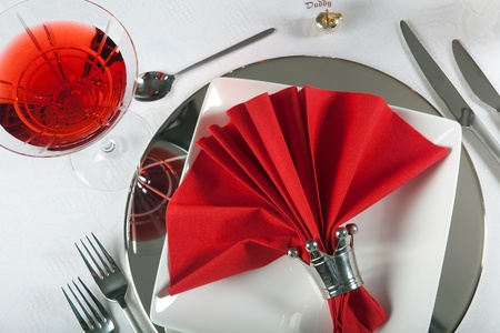red tablecloth: Festive Christmas or wedding table with red napkins on a white tablecloth