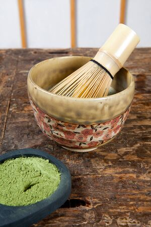Bamboo wire whisk for zen tea ceremony with green powder tea photo