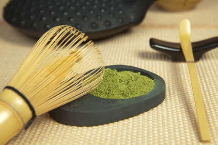 mat like: Still life of green powder tea with teapot and bamboo whisk for zen ceremony