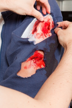 simulations: Professional makeup artist making a realistc wound