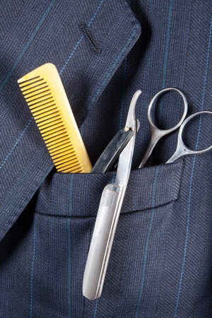 breast pocket: Comb with razor blade and scissors in a breast pocket of a formal business suit Stock Photo