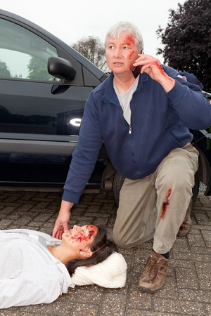 Wounded man calling for help after a car accident photo