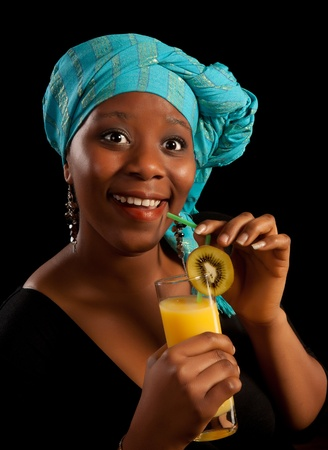 Surprised look on the face of a young african woman having a drink Stock Photo - 11423574