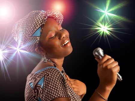 ghanese: Stage performance of a young Ghanese woman singing Stock Photo
