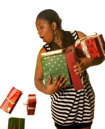 dropping: Young african girl dropping a few christmas presents Stock Photo