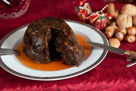 Christmas dinner table with xmas pudding as dessert photo