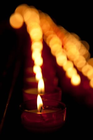Background image of hundreds of blurred burning candles Stock Photo - 11423589