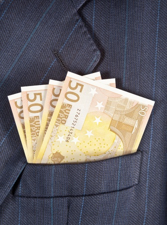 Euro banknotes in a breast pocket of a business man photo