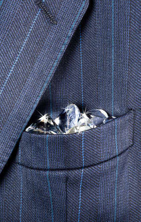 breast pocket: Shiny diamonds in a breast pocket of a formal business suit Stock Photo