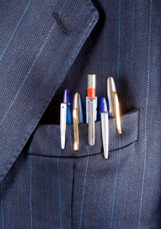 breast pocket: Fountain pens and ballpoints in a breast pocket of a formal business suit