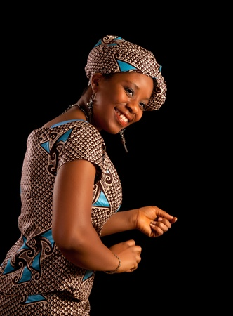 Beautiful young Ghanese african woman showing a dance in her traditional national costume photo