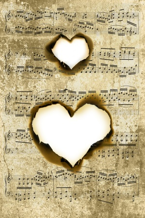 old sheet music: Sheet of parchment with heart shape burnt holes (the music is over 200 years old, by Haydn)