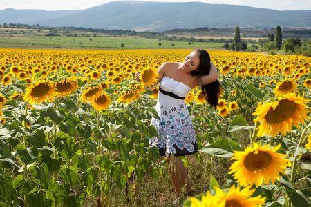 bulgaria girl: Pretty woman walking alone in a Bulgarian sunflower field
