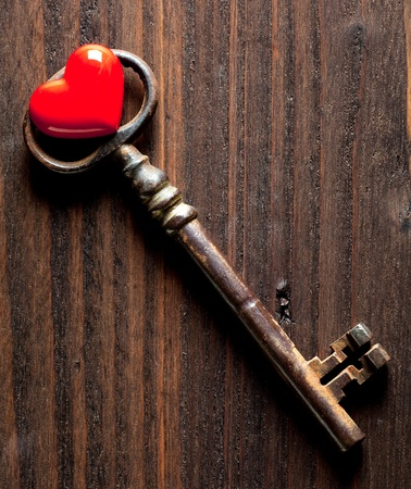 old key: Antique rusty key and a red heart for Valentines day Stock Photo