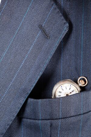 breast pocket: Antique pocket-watch in a breast pocket of a formal business suit