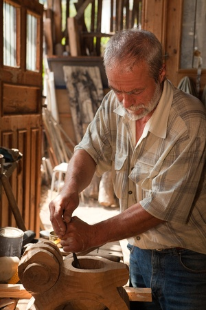 artisan: Craftsman at work in his shed working with wood Stock Photo