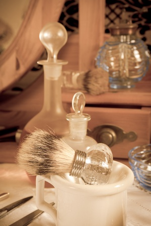 Sepia image of the tools of an antique victorian barber photo