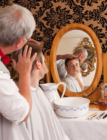 Historical re-enactment of an old victorian barber shop Stock Photo - 12250355