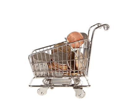 spending full: Small shopping trolley full of dollars for spending
