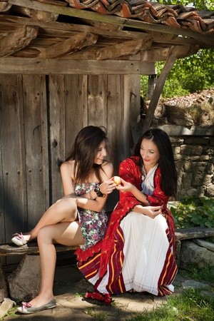 bulgarian ethnicity: Modern and traditional folklore women sharing an apple in a village in Bulgaria
