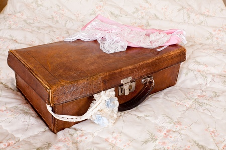 Vintage garter with blue bow in a suitcase waiting for the bride Stock Photo - 12609422