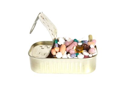sardine can: Sardine can filled with colorfull pills and tablets