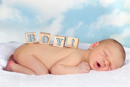 Four wooden blocks with BOY on the back of a sleeping baby Stock Photo - 12880180