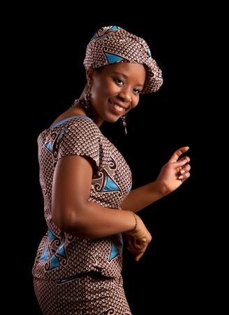 happy african: Young Ghanese african woman showing a dance in her traditional national costume