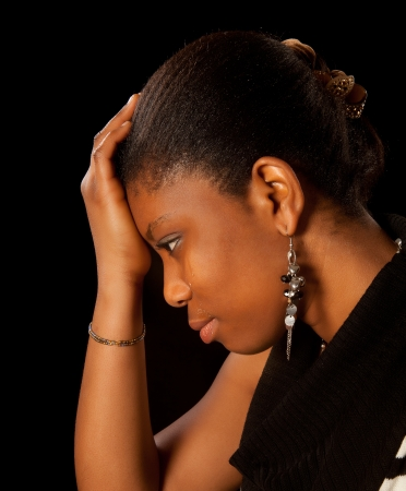 Wet tears running of the face of a young african woman Stock Photo