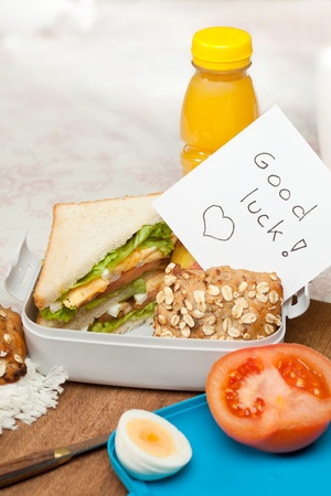 fresh graduate: Lunchbox with good luck note for graduation or first day at work or school
