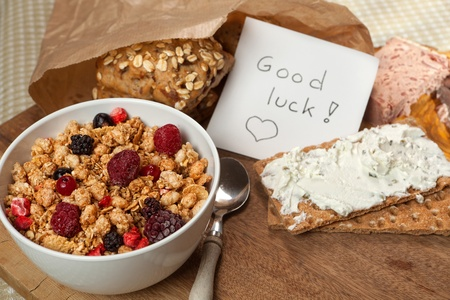 Good luck message on the breakfast table next to cereals photo