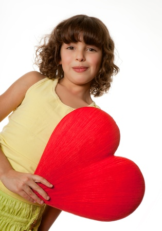 Little girl holding a big red heart for mother's day photo