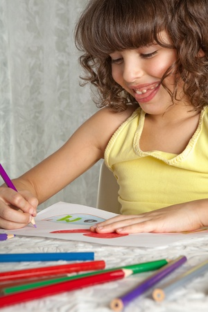 Little girl making a drawing for mother's day photo