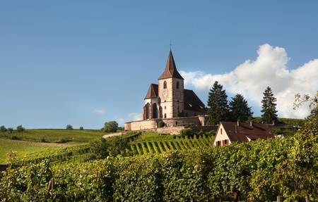 alsace: Little church of Hunawihr wine village in the middle of vineyards of Alsace, France