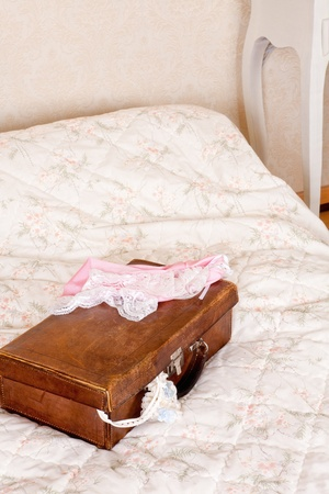 Honeymoon suitcase with cream and blue garter and other lace lingerie Stock Photo - 13058117