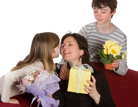 Boy and girl hugging their mother on mothers day photo