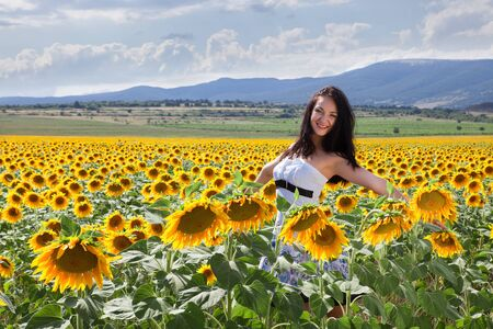 Bulgarian woman posing in a summer sunflower field photo