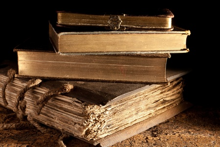 Small stack of antique books in weatered grungy state and gold edged photo