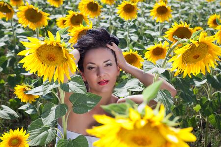 Closeup portrait of a young woman in a sunflower field in Bulgaria Stock Photo - 13318921