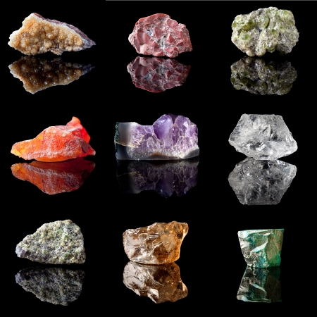 crystals: Series of semi-precious gemstones in uncut unpolished state. Citrine, Jasper, Peridote, Chalcedone, Amethyst, Rock Crystal, Olivine, Smokey Quartz and Malachite Stock Photo