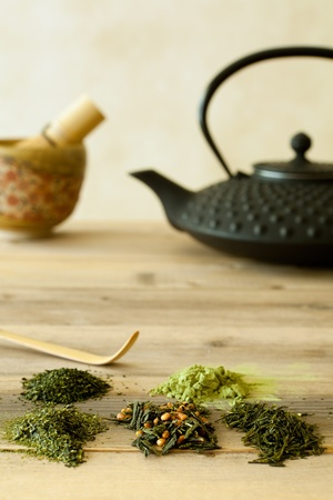 Green tea sorts from Japan with black teapot and bamboo whisk Stock Photo - 13454159