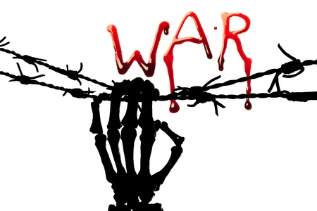 War in bleeding letters and a silhouette of a skeleton hand holding barbed wire photo