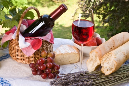 Romantic lunch setting with wine, bread and fruit