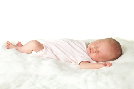 Soft white furry blanket with an newborn baby of 18 days old photo