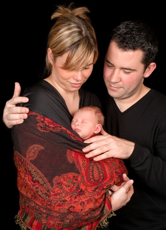 Family portrait of a happy couple with their 18 days old baby Stock Photo - 13563605